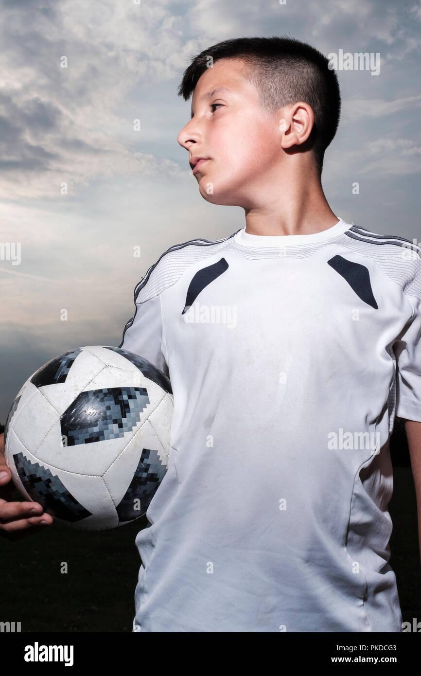 Boy-10-11 years old in football kit,Surrey,UK - Stock Image