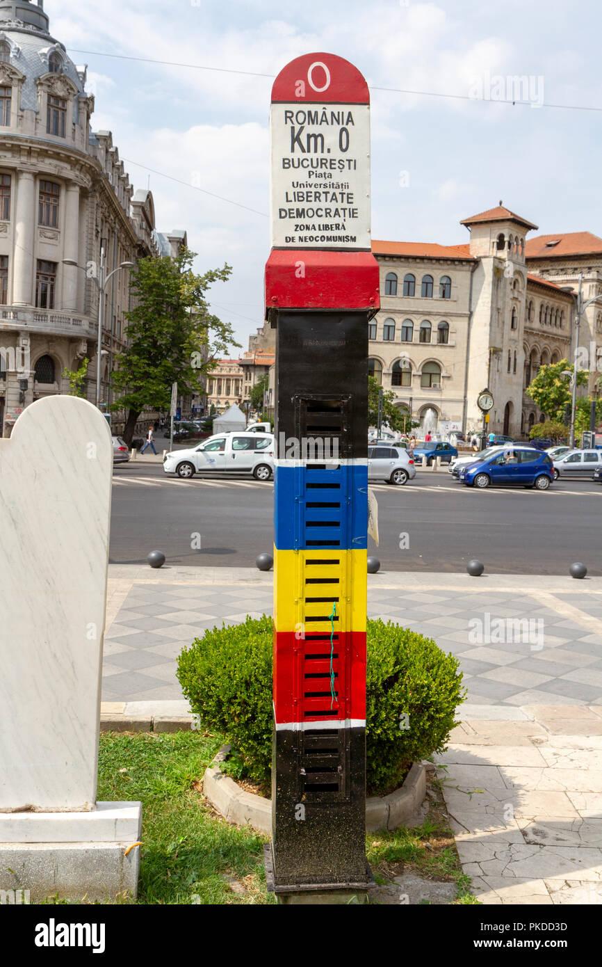 The road side 0 km marker (Kilometrul Zero) outside the National Theatre Bucharest (Teatrul Național București) in Bucharest, Romania. - Stock Image