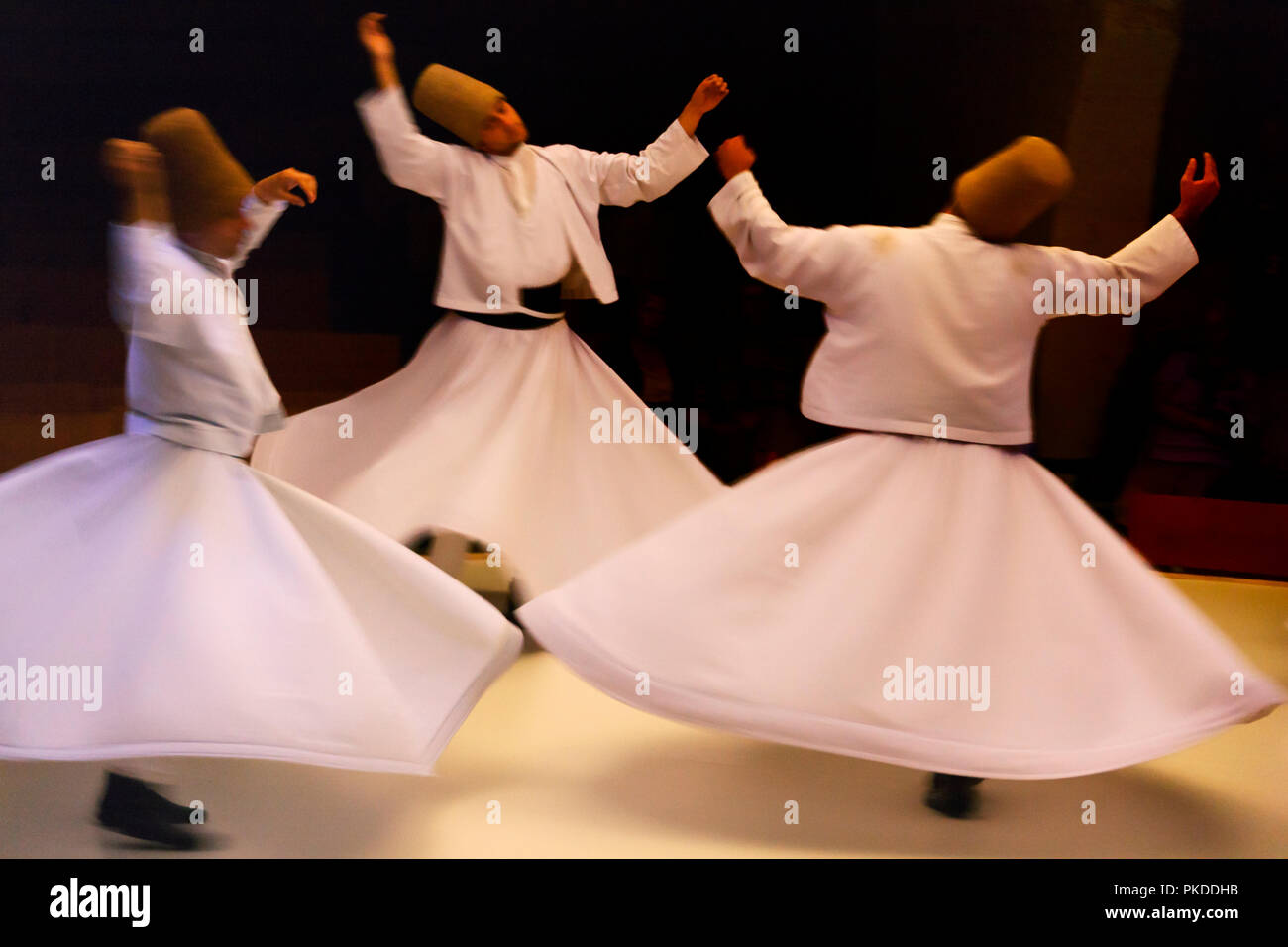 Whirling dervishes dancing, Goreme, Cappadocia, Turkey - Stock Image