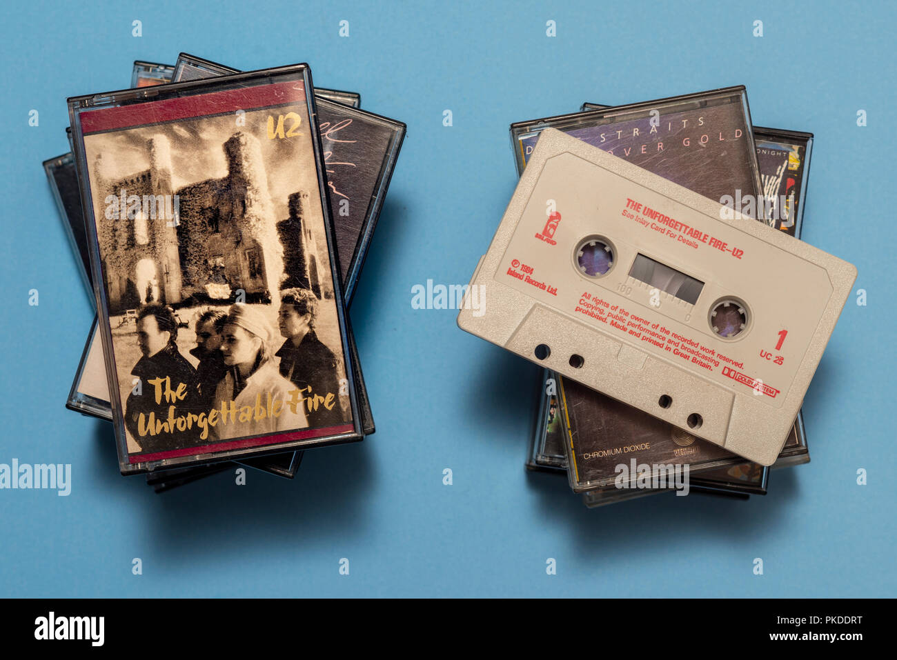 compact audio cassette of U2, Unforgetable Fire album with art work. - Stock Image