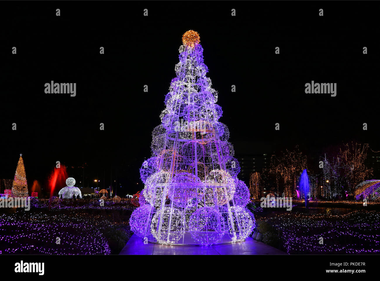Outdoor Light Up Christmas Tree.Outdoor Illuminated Christmas Decorations Glittering Against