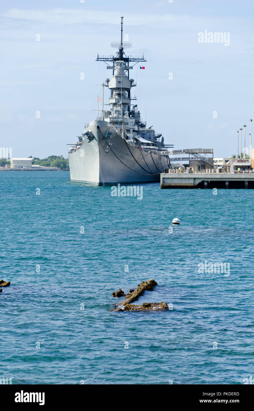 The WWII US navy ship USS Missouri anchored in Pearl Harbor, Hawaii. Part of the sunken USS Missouri is visible in foreground.  Taken in 2010. - Stock Image