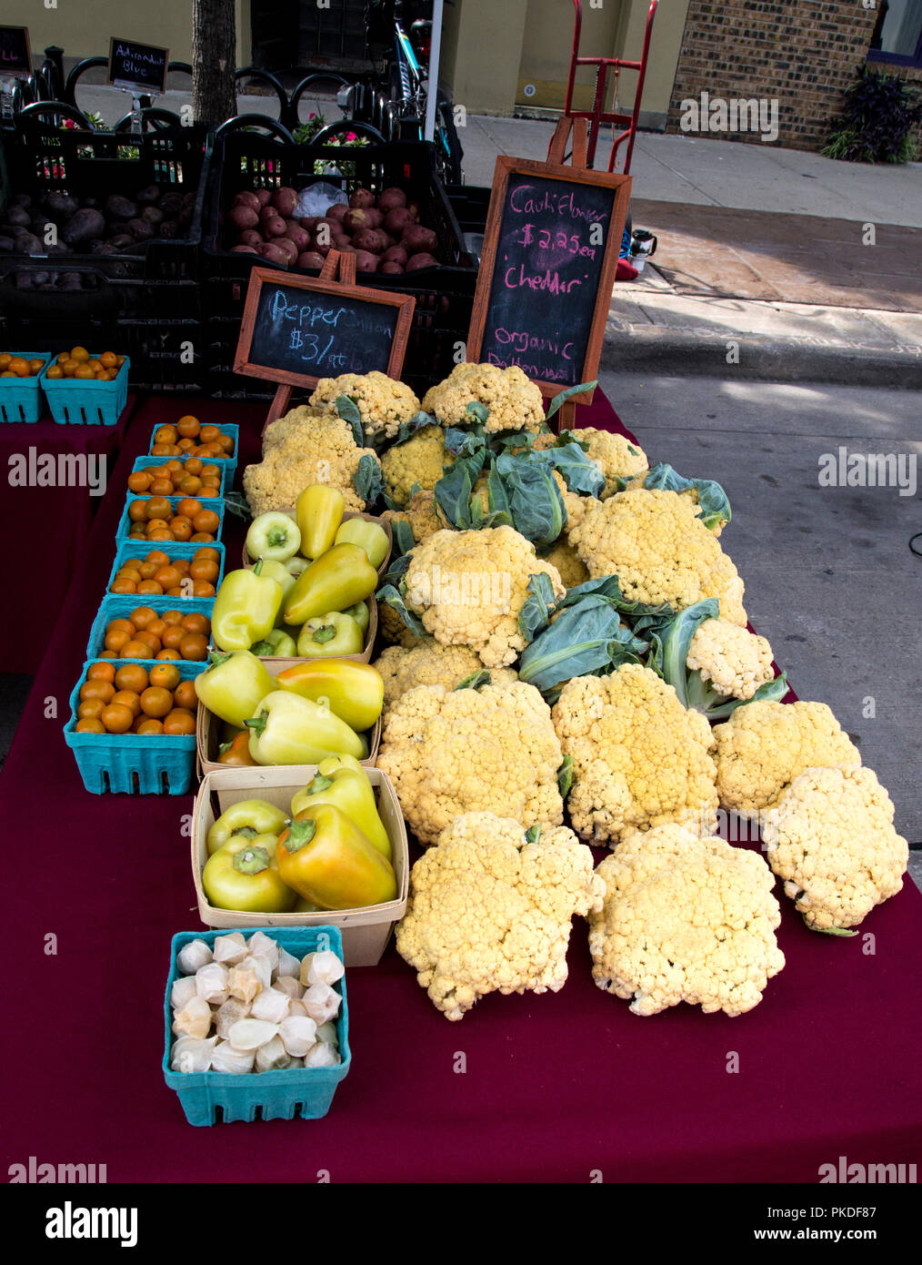 Farmers market in Appleton Wisconsin with a display of 'Cheddar' cauliflower - Stock Image