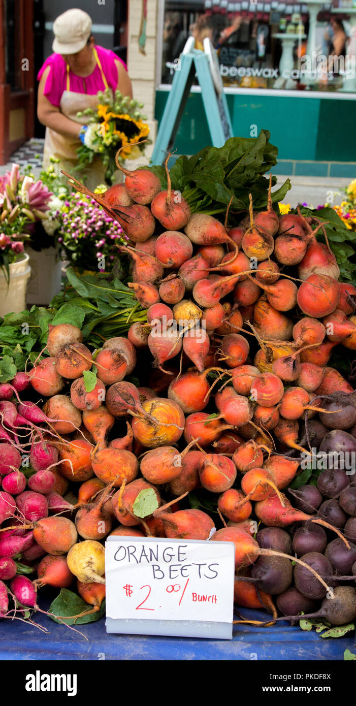 Farmers market in Appleton Wisconsin with a display of unusual orange beets - Stock Image