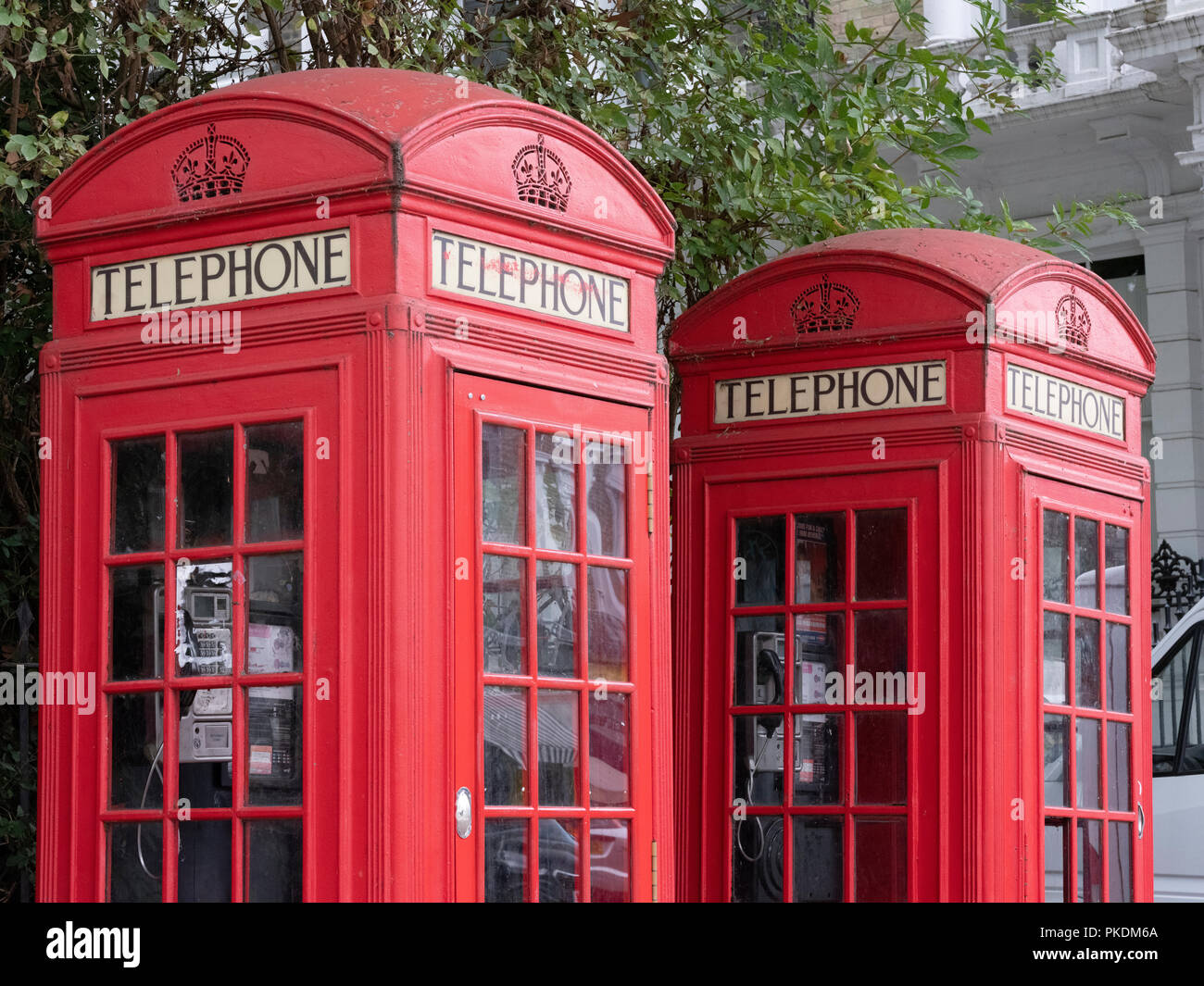 A pair of K2 red telephone boxes, the original design by Sir Giles Gilbert Scott in Regent's Park - Stock Image