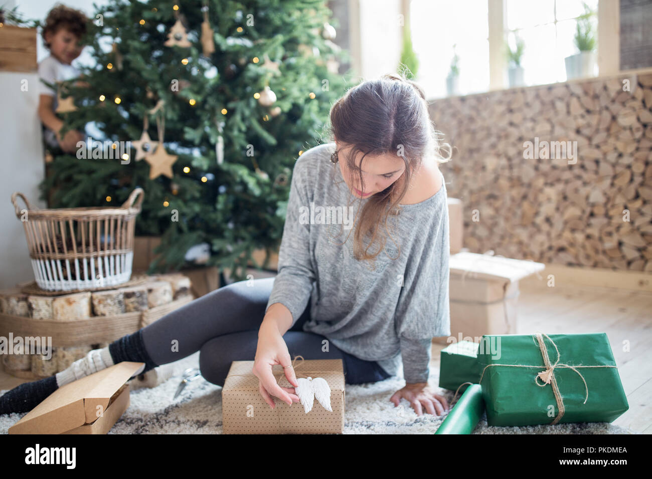 Mother Christmas Gifts.Mother Wrapping Christmas Gifts For Family Preparing