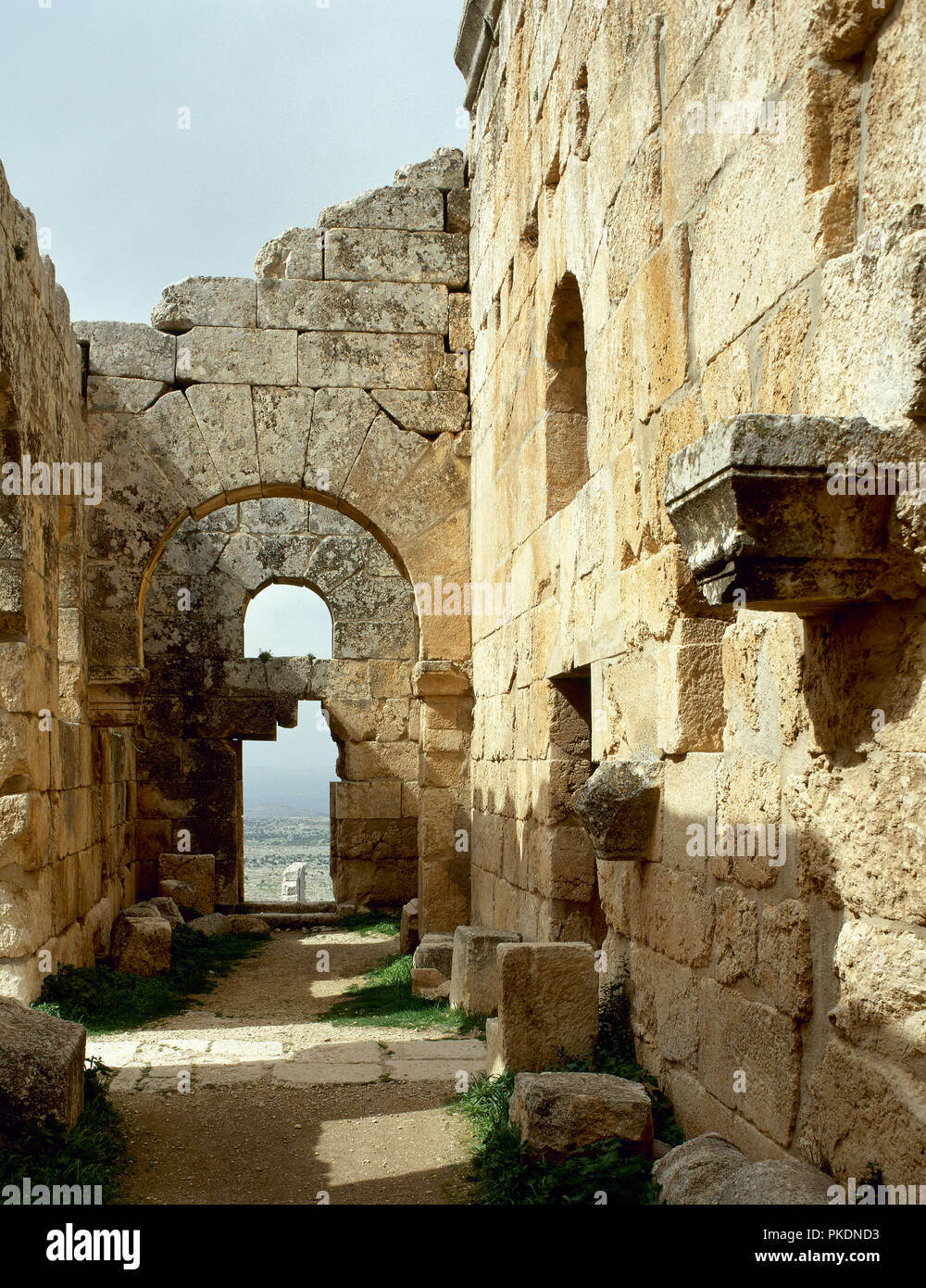 Church of St Simeon Stylites, 475. It was built on the site of the pillar of St. Simeon. Architectural detail of the chapel and the inn, near the hill. Aleppo. Syria. Historical photography (before Syrian Civil War). - Stock Image