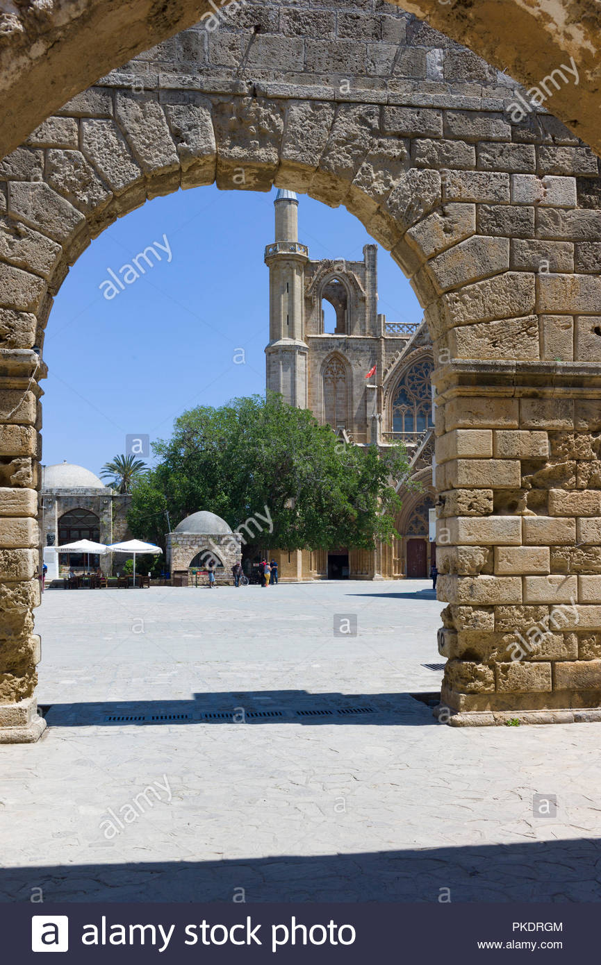 Part of the Othello Castle in Famagusta, Northern Cyprus with the Lala Mustafa Pasha Mosque, or the St. Nicholas Cathedral in the background Stock Photo