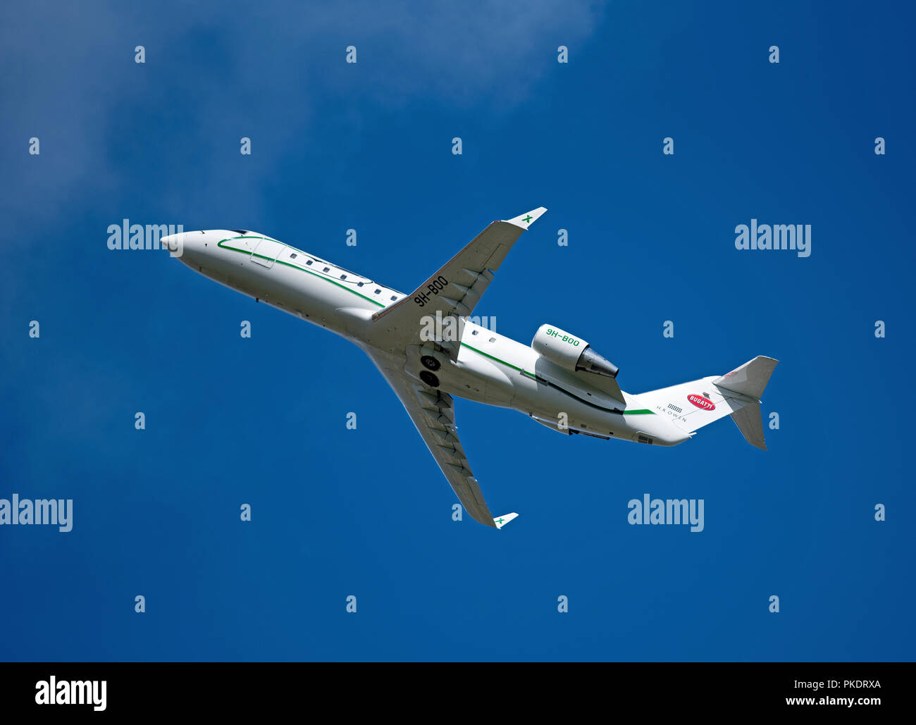 A Bombardier Challenger 850 Reg 9H-BOO visit to Inverness inverness Airport in the Scottish Highlands  UK. - Stock Image