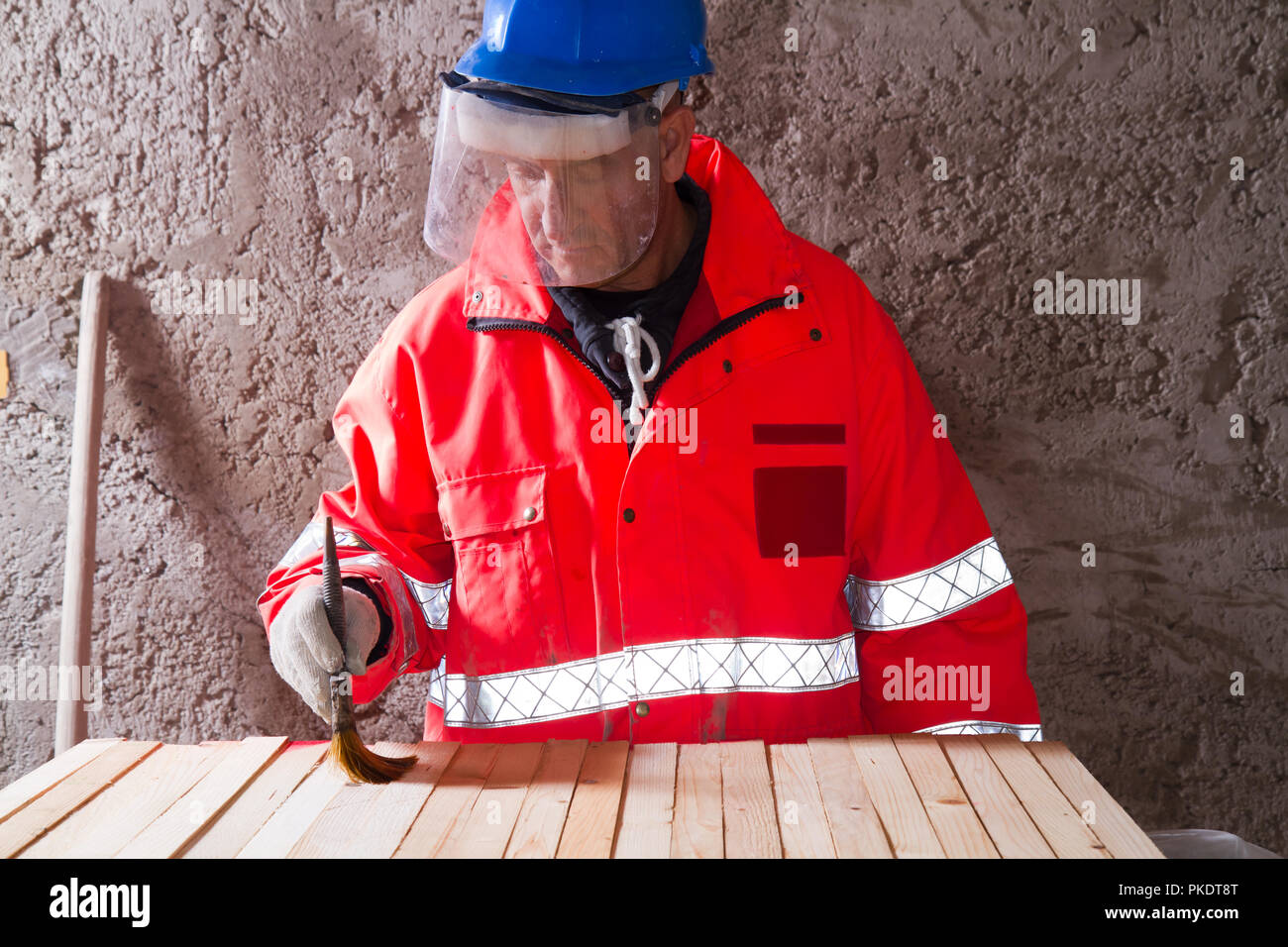 carpenter at work in a building site - Stock Image