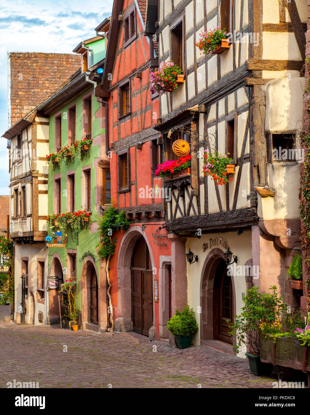 Half-Timbered buildings on Rue du General de Gaulle in Riquewihr - along the Wine Route, Alsace Haut-Rhin France - Stock Image