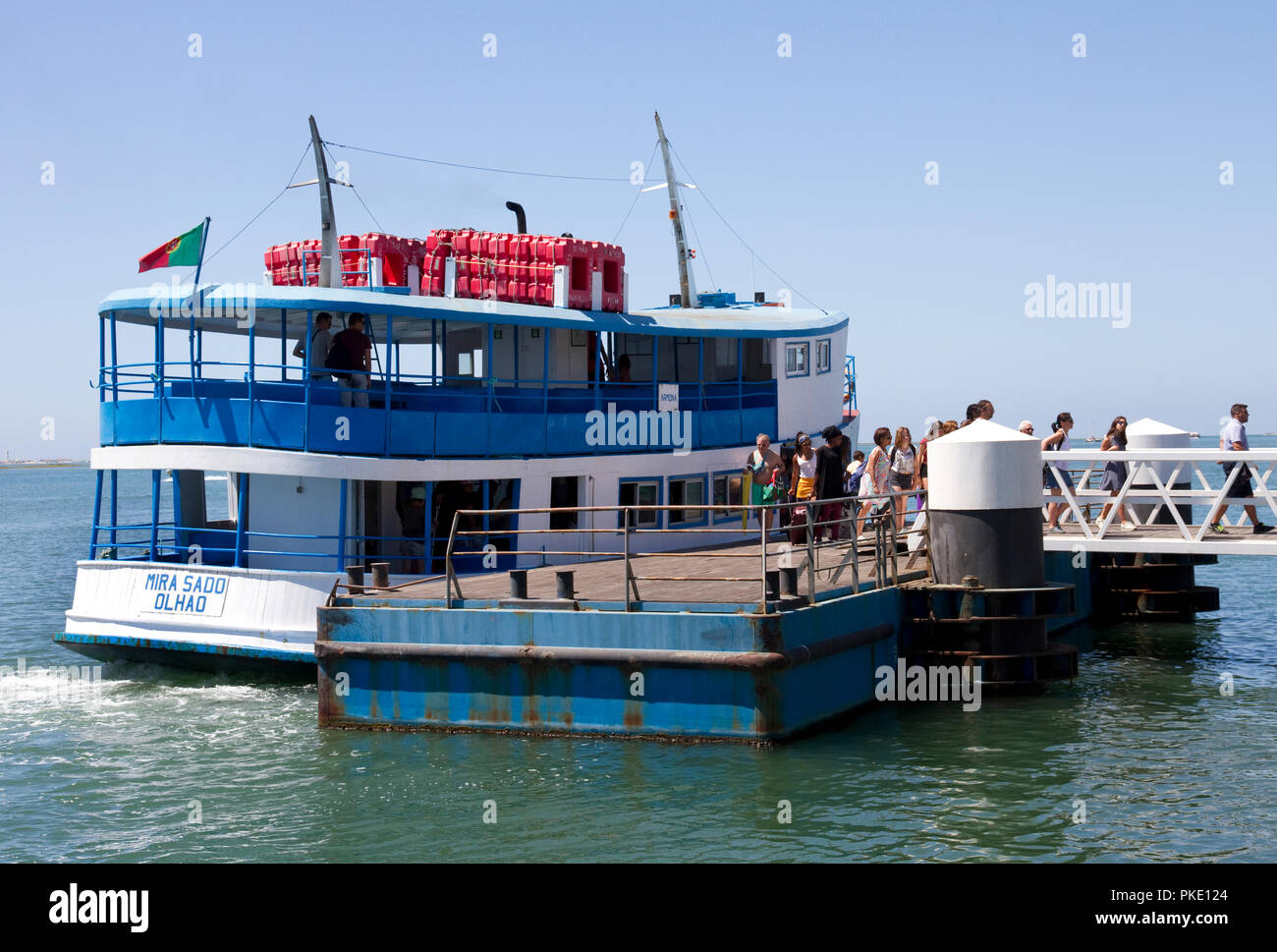 Harbour, Olhao, Algarve, Portugal. People getting off ferry Ferry to islands of Culatra-Farol, Armona, Ria Formosa Natural Park. - Stock Image