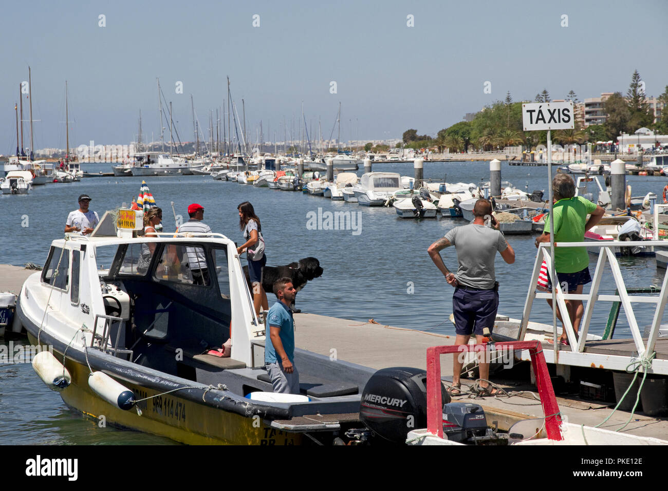 Water taxis to beaches and islands of Ria Formosa. Harbour, Olhao, Algarve, Portugal - Stock Image