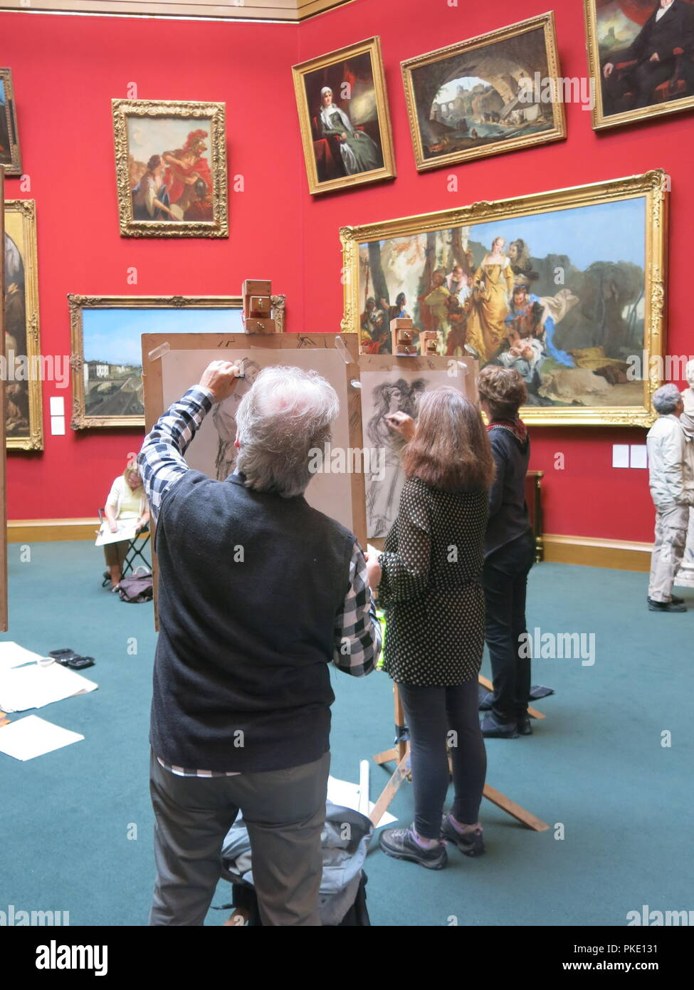 A drop-in session for the public at the Scottish National Gallery on Edinburgh's Princes Street lets you have a go at easel sketching in the Main Hall. Stock Photo
