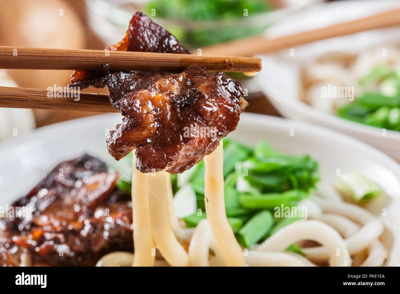 Japanese Udon noodles with beef, green onion and soup in a dish Stock Photo