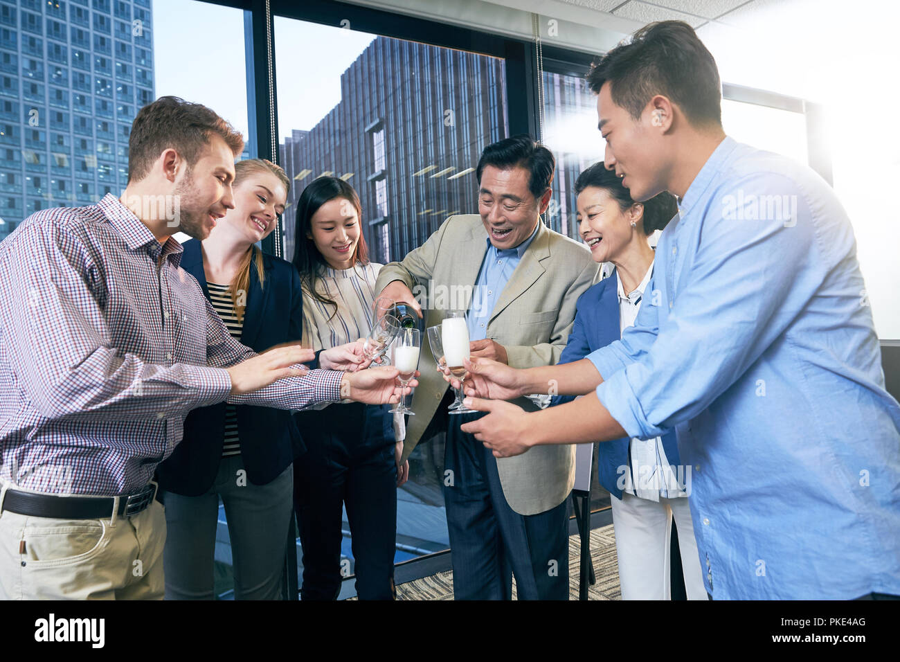 Business men and women in the office - Stock Image