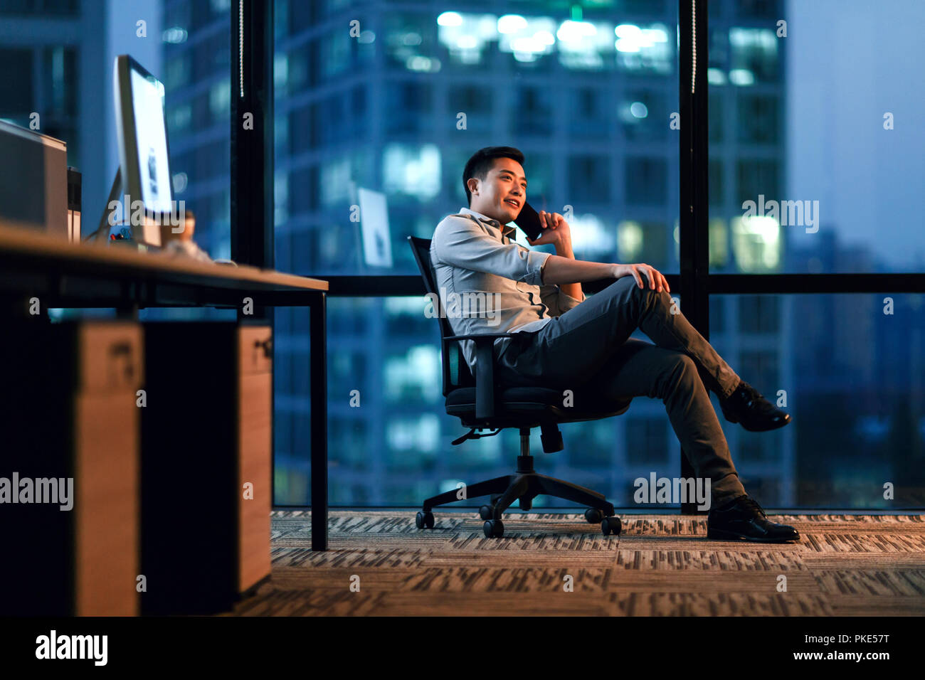 Business men in the office to work overtime Stock Photo