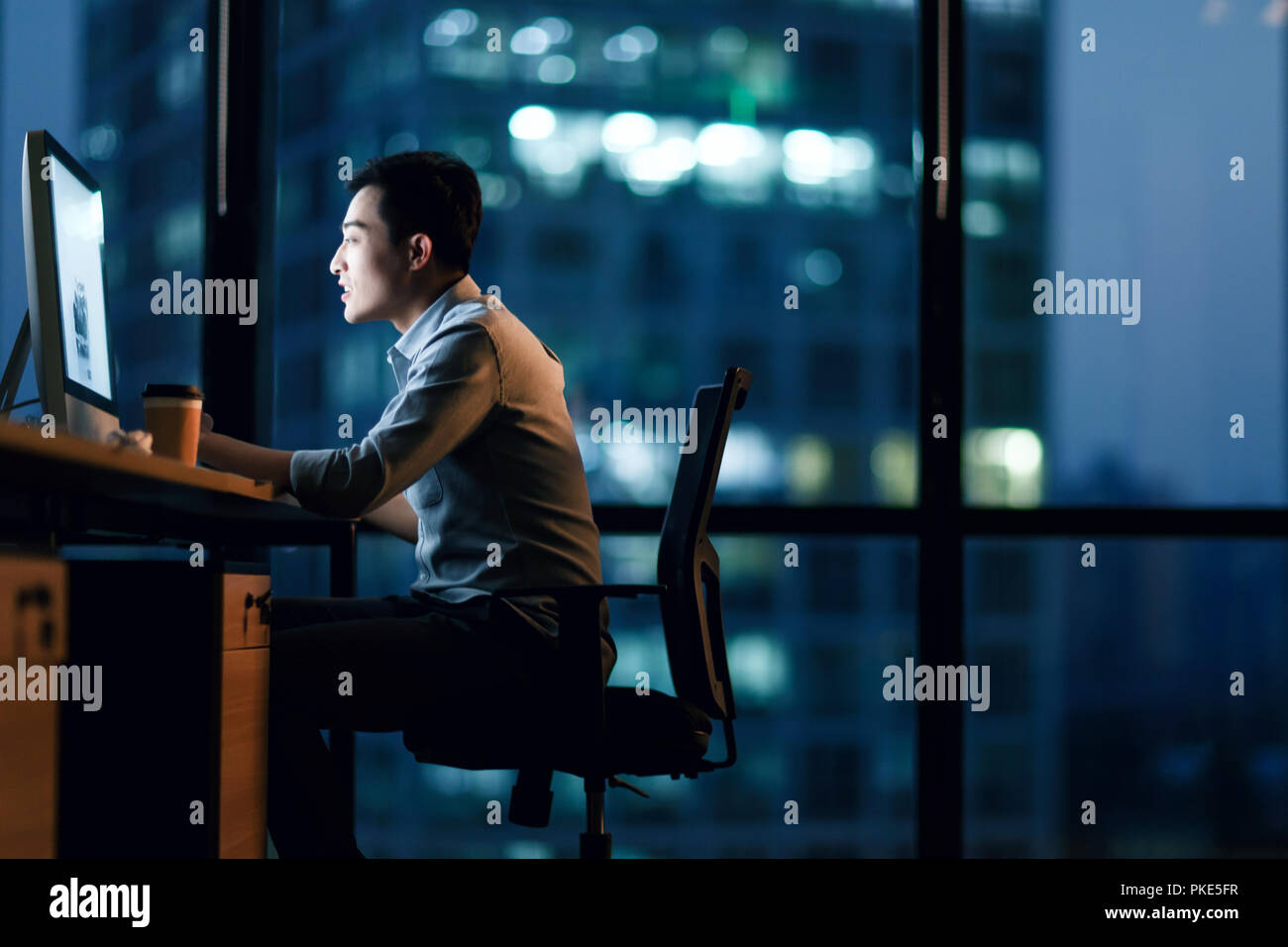 Business men in the office to work overtime - Stock Image