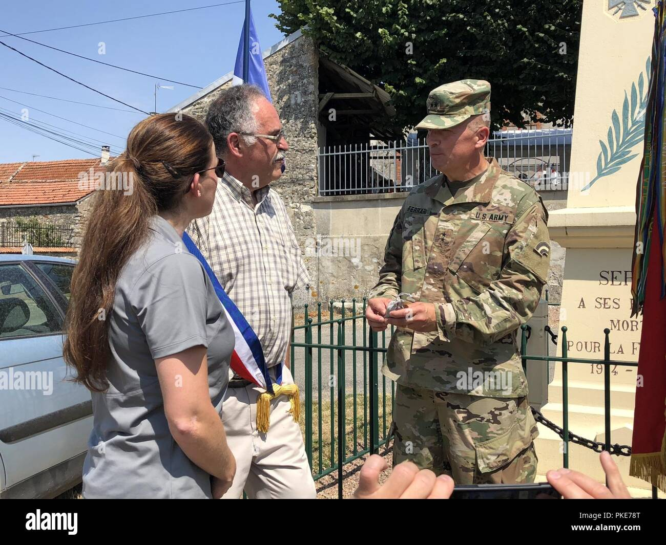 Major General Steven Ferrari the 42nd Infantry Division Commander receives a gift from the Mayor of Sergy, France on July 27, 2018. The Soldiers from the Division participated in the Croix Rouge Farm ten mile walk, some of the Soldiers started at the town of Sergy, France where the Division lost Soldiers in that town during World War One. The Croix Rouge Farm battlefield tour was a 10-mile road march of historic sites of the Rainbow Division's first offensive actions from July 25-30, 1918. The assault of the division was part of the first allied attack across a 25-mile front near Soissons and  - Stock Image
