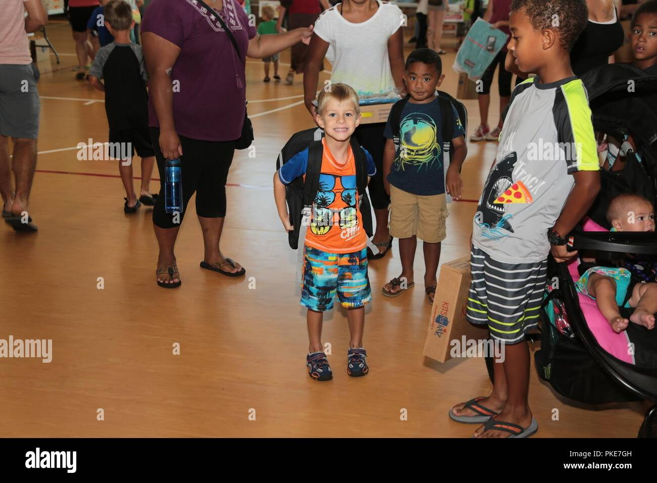 FORT BENNING, Ga. (July 27, 2018) – To accommodate service members with school-age children, Fort Benning Family and Morale, Welfare and Recreation (MWR) held two back-to-school events July 26 and July 27. The main event was child and Youth Services' Back-2-School Bash July 27, where parents and their school-age children lined up around the block to the Youth Services Campus to pick up free school supplies and meet several of the on-post services available to them. The Exceptional Family Member Program (EFMP), Army Community Service, MWR, held a similar but smaller back-to-school luau at Breez - Stock Image