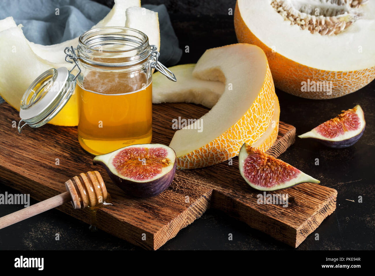 Fresh melon, honey and figs. Fruit snack. selective focus - Stock Image