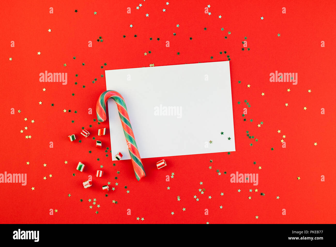 creative new year or christmas greetings letter mockup flat lay top view xmas holiday celebration envelope on red paper background golden glitter tem