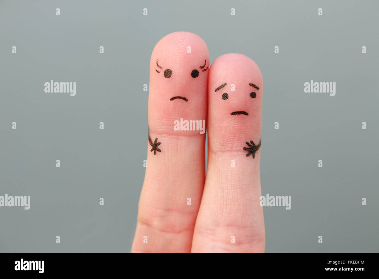 Fingers art of couple. Concept woman taller than man. - Stock Image