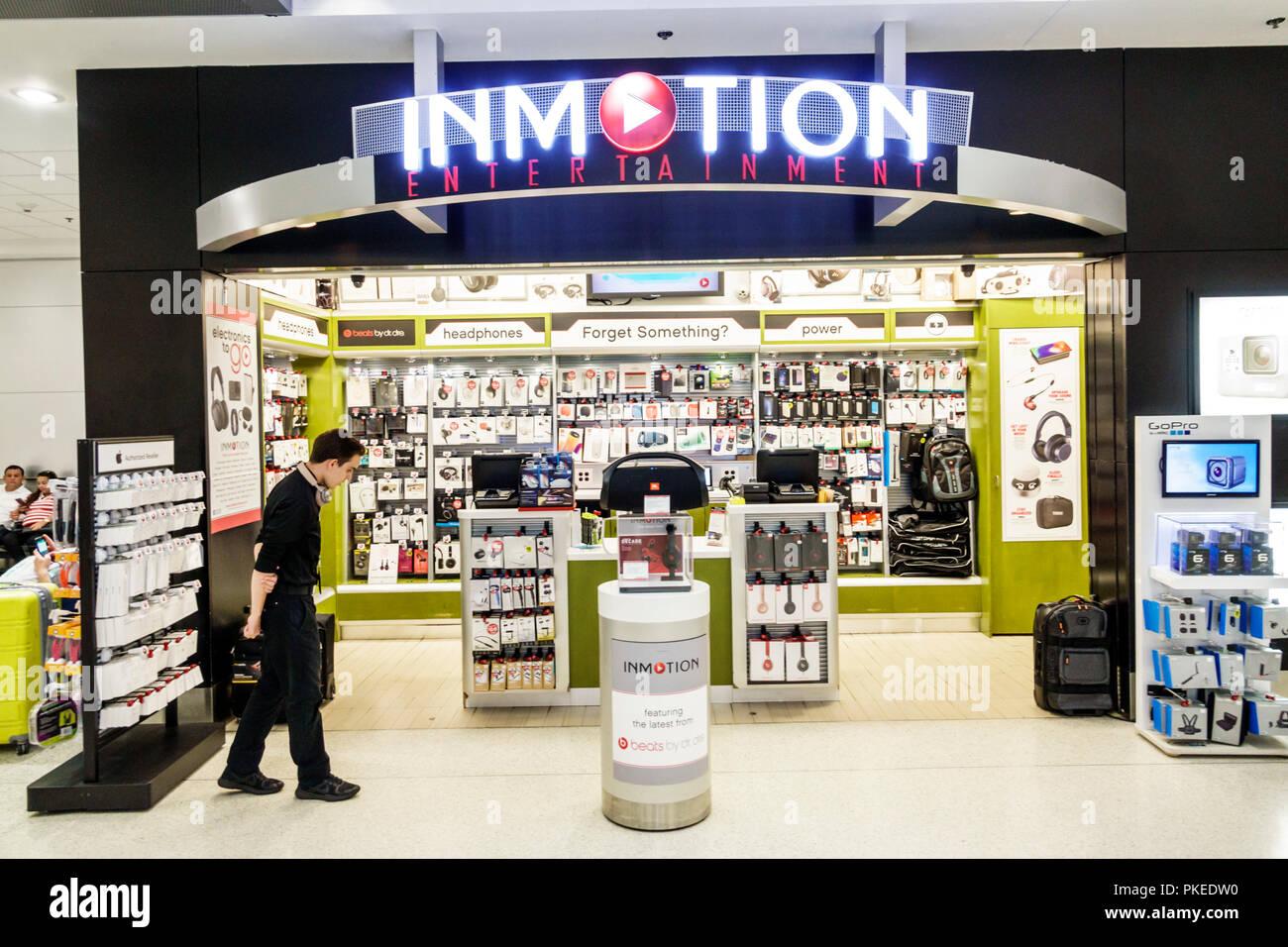 Miami Florida International Airport MIA terminal concourse gate area store shopping concession Inmotion Entertainment electronics retailer business - Stock Image