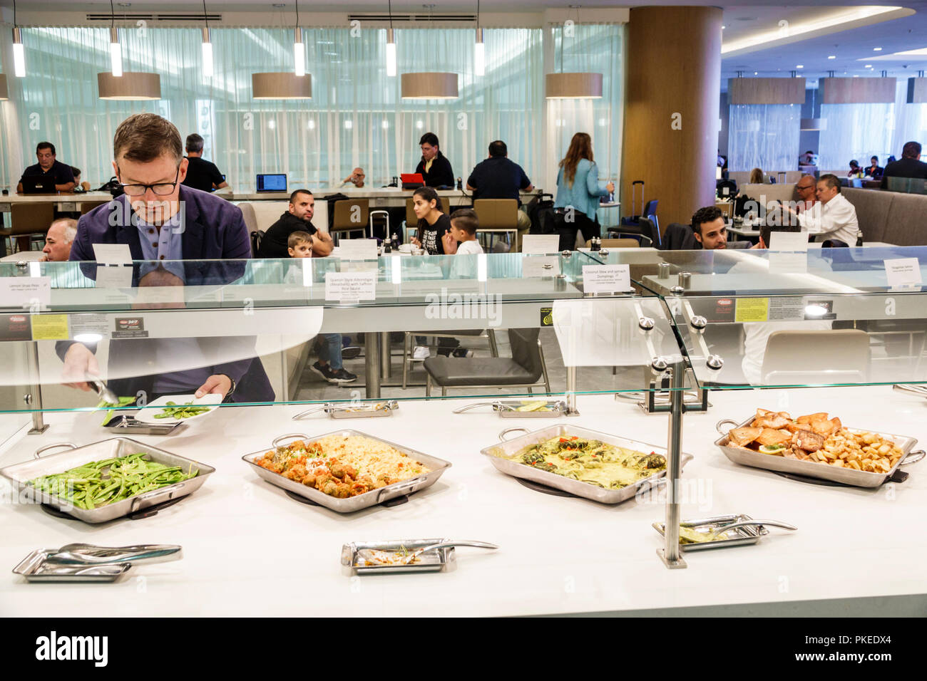 Miami Florida International Airport MIA Terminal Concourse Gate Area American Airlines Business Class Flagship Lounge Dining Room Buffet Man Serving T