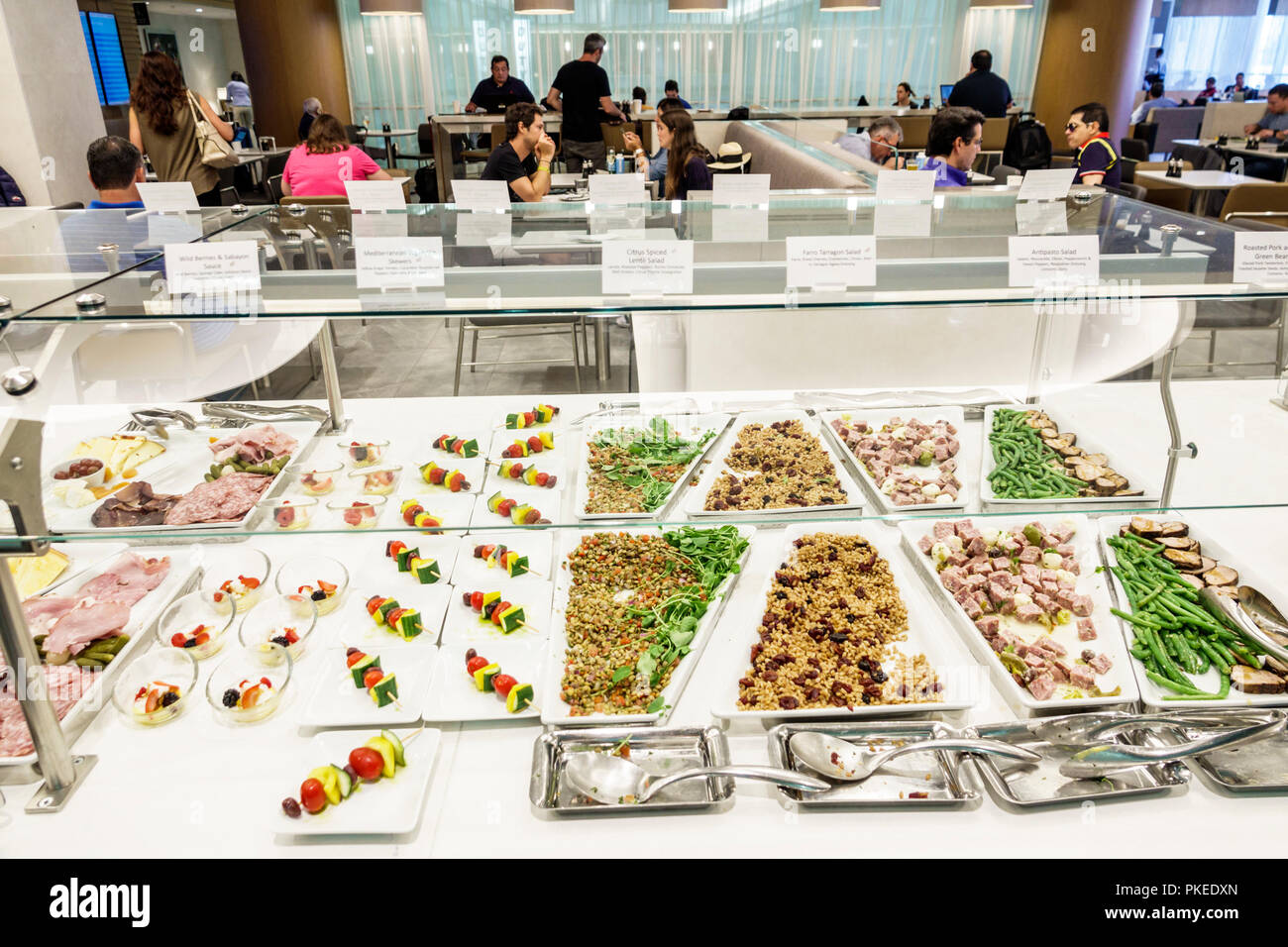 Miami Florida International Airport MIA Terminal Concourse Gate Area American Airlines Business Class Flagship Lounge Dining Room Food Trays Buffet