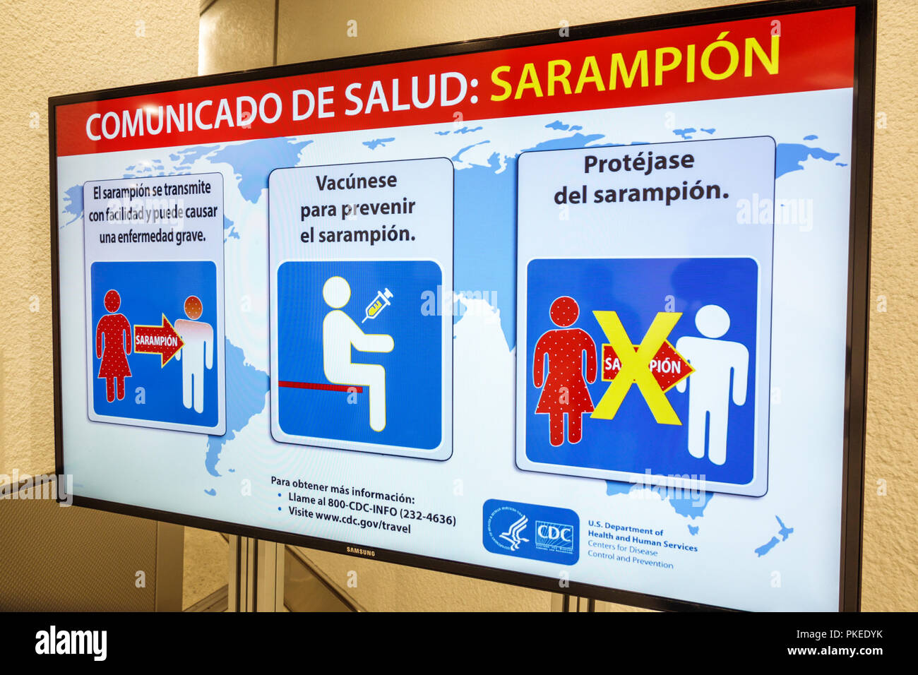Miami Florida International Airport MIA health information sign CDC Center for Disease Control sarampion measles warning vaccine Spanish language - Stock Image