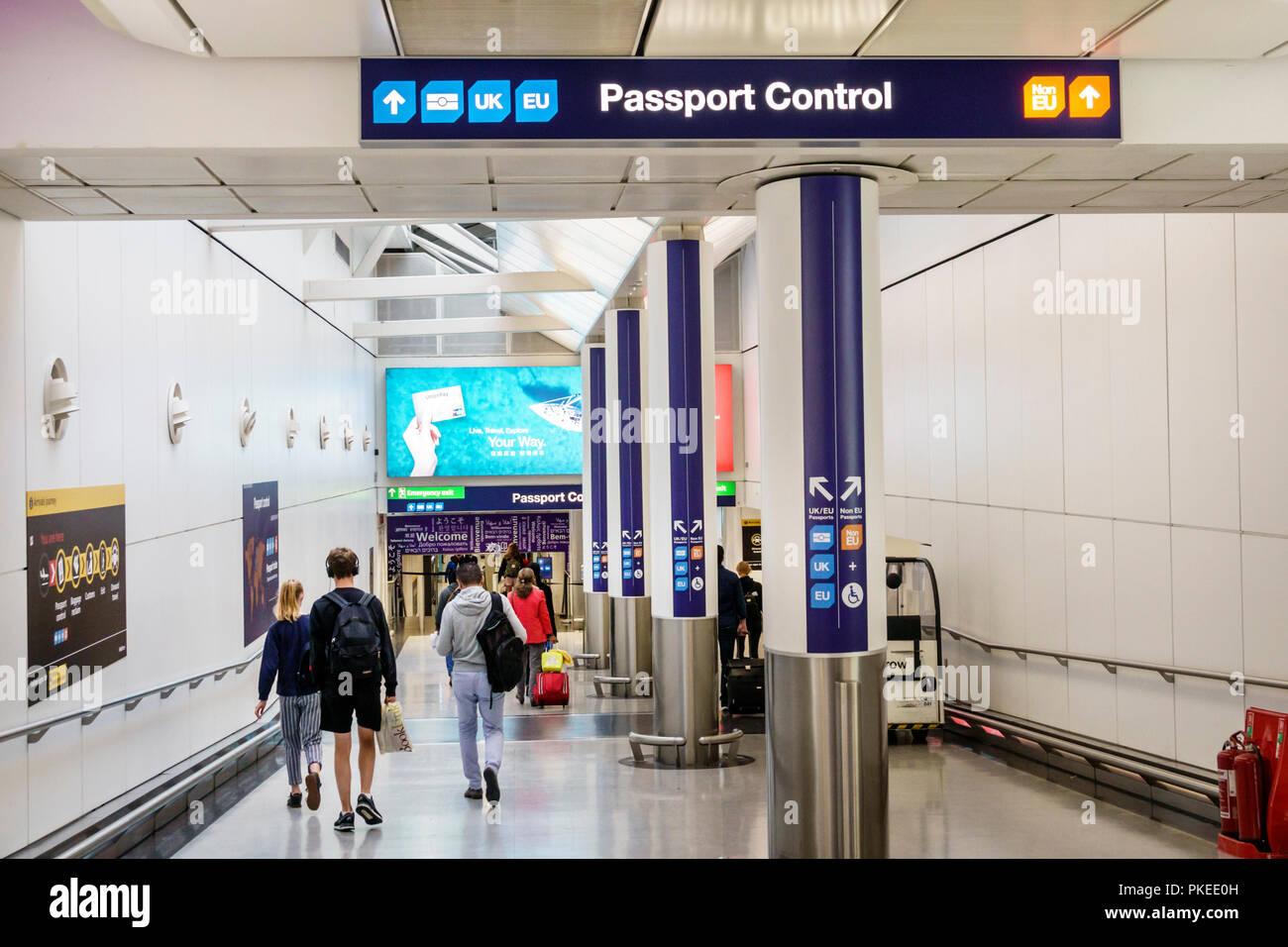 London England Great Britain United Kingdom Heathrow Airport LHR ramp passport control sign directions - Stock Image