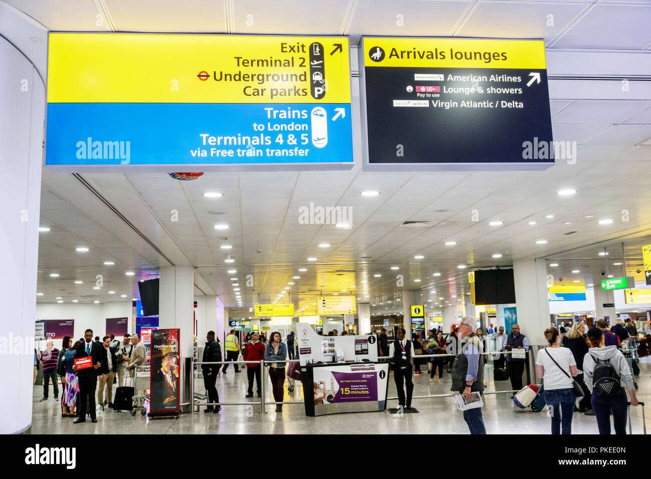 London England Great Britain United Kingdom Heathrow Airport LHR sign directions arrival lounges trains underground - Stock Image