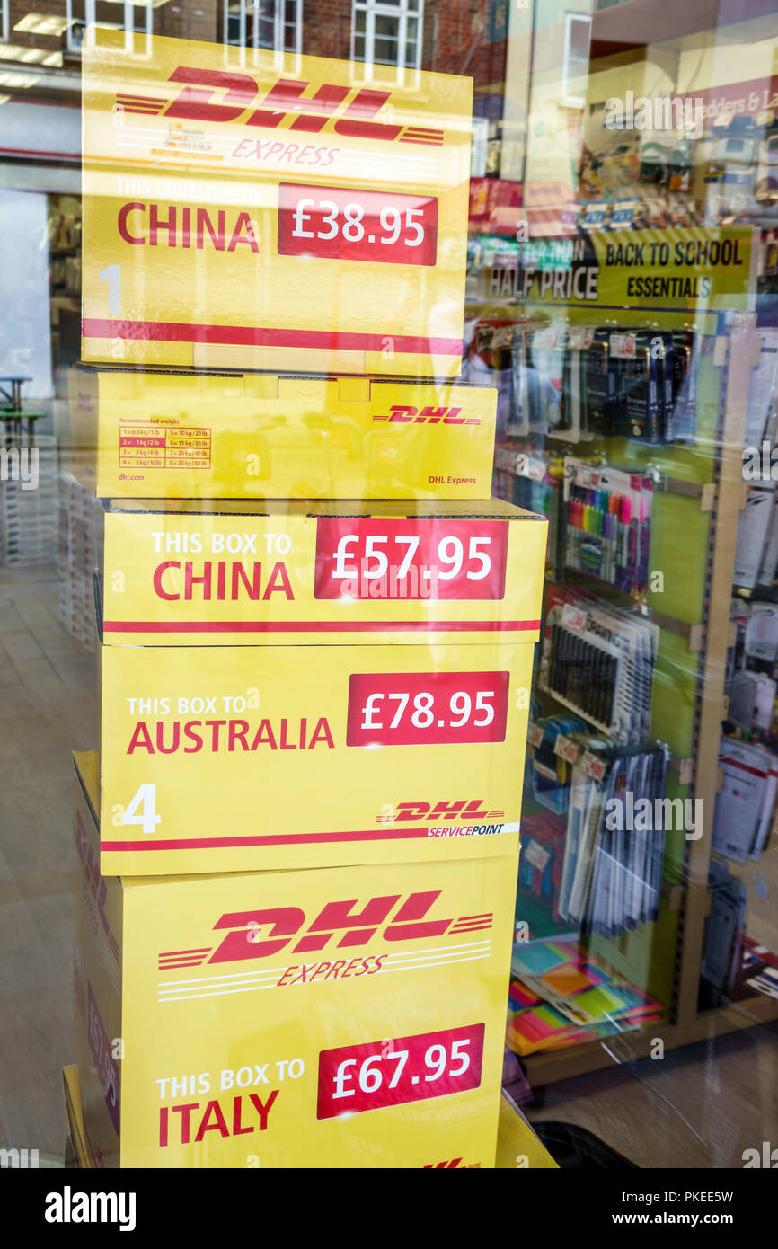London England Great Britain United Kingdom South Bank Lambeth DHL international courier parcel shipping storefront window display prices pound sterli - Stock Image