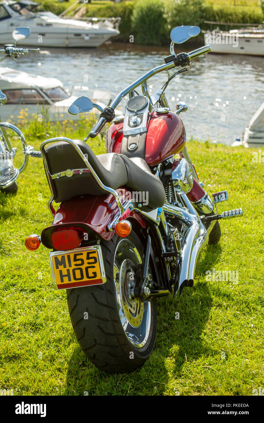 Gleaming Red Harley-Davidson Sportster motorbike - Stock Image