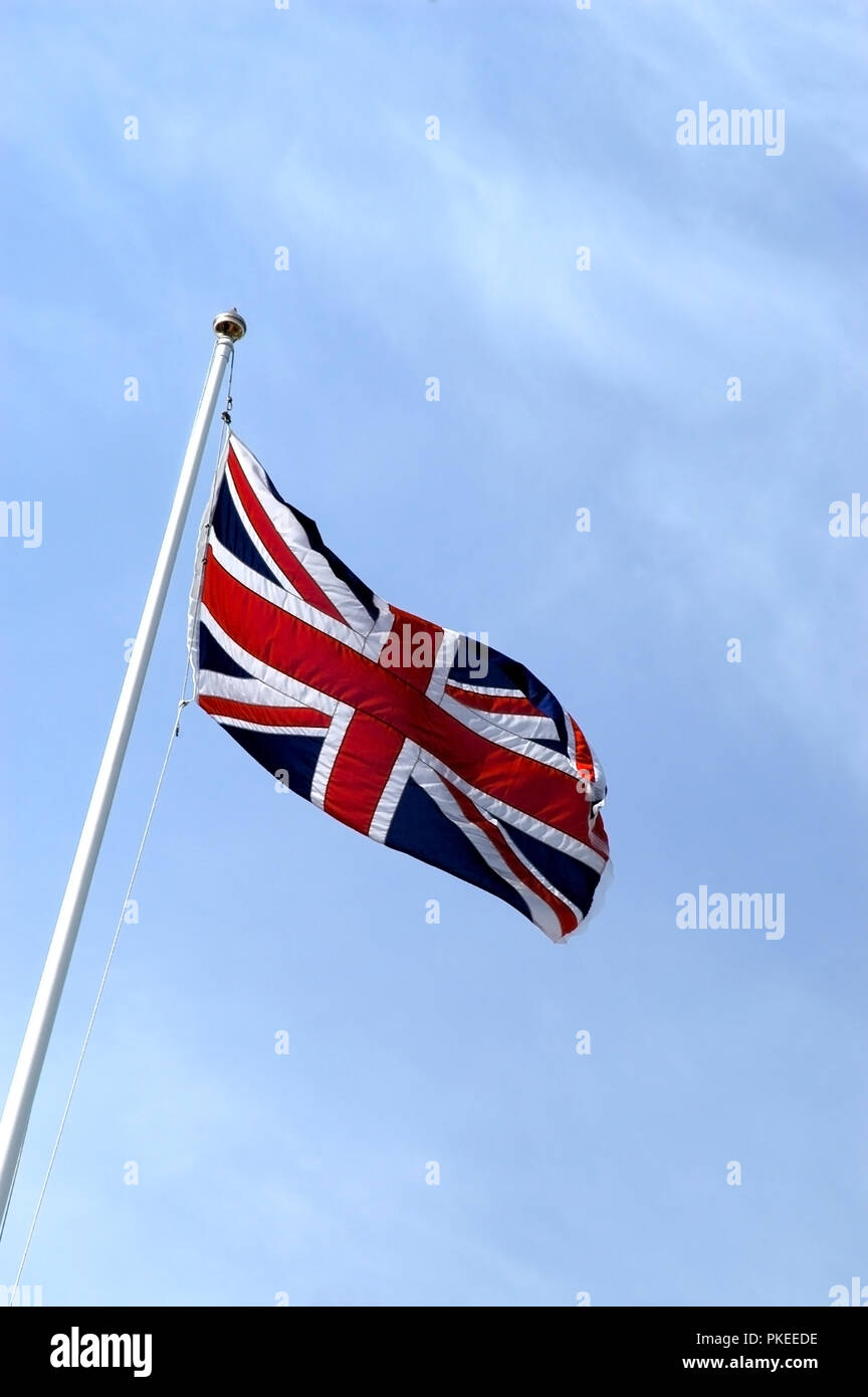 Flagpole with Union Jack Flag blowing in the wind - Stock Image