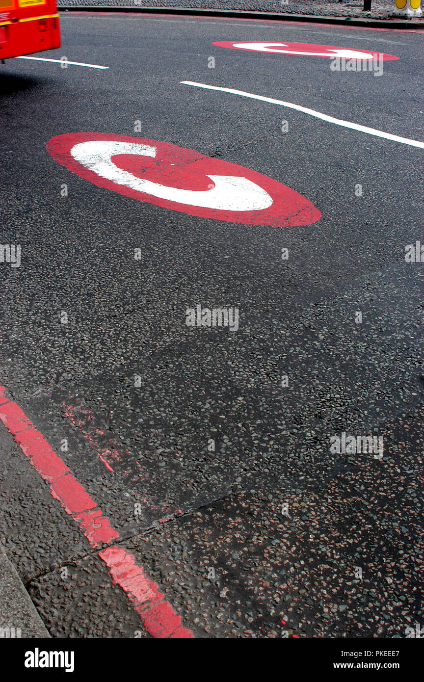 White C in red circle marked  C on a road for Congestion Charge. Daily charge Congestion Charge zone - Stock Image