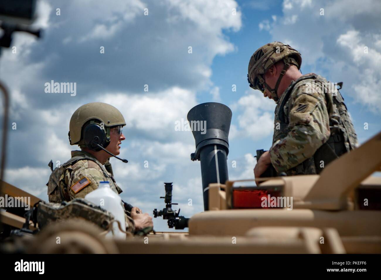 Gunner Pfc. Austin Hutchenson (left) and Assistant Gunner Pfc.Terry Tompakou (right) of B Co., 6th Squadron, 8th Cavalry Regiment, 2nd Armored Brigade Combat Team prepare to receive gun data from their Tank Commander at Gunnery IV, V, and VI at Fort Stewart, Ga., July 23. The mortar platoon's mission is to provide close and immediate indirect fire support for battalions and companies. Stock Photo