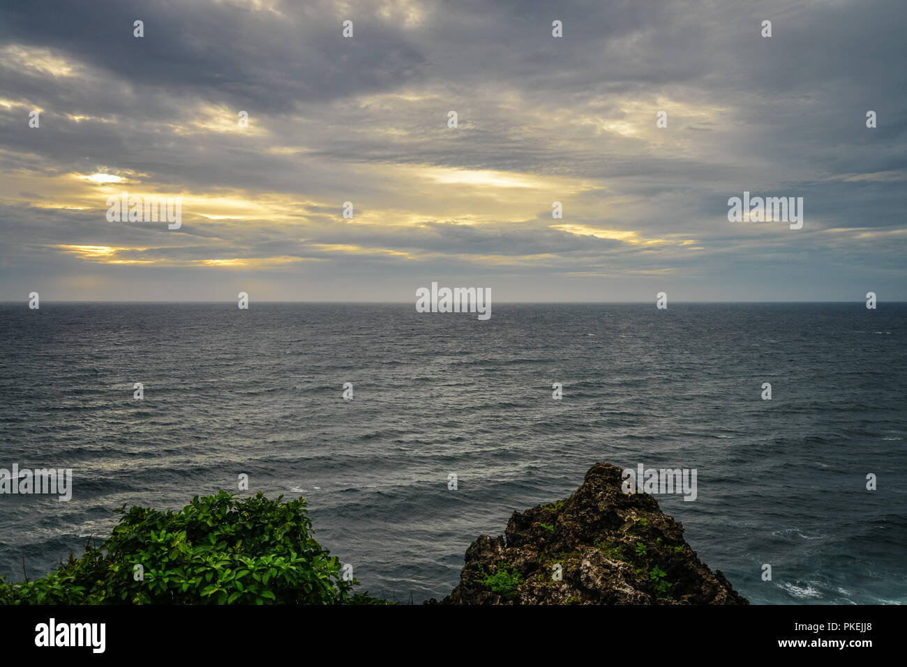 View from Pura Luhur Uluwatu temple, Bali, Indonesia on sunset over the sea. - Stock Image