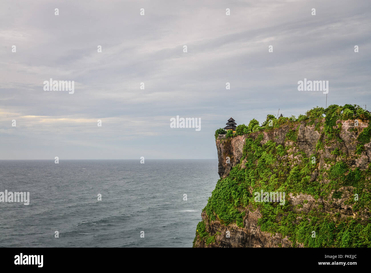 Pura Luhur Uluwatu temple, Bali, Indonesia. Amazing landscape - cliff with blue sky and sea Stock Photo