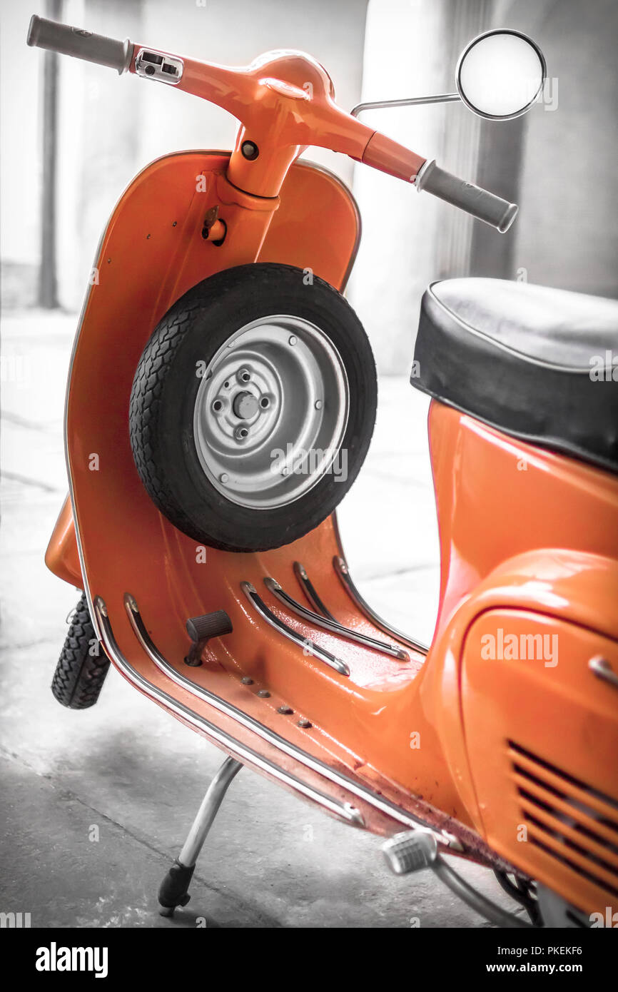 Vintage scooter parked in the garage - Stock Image