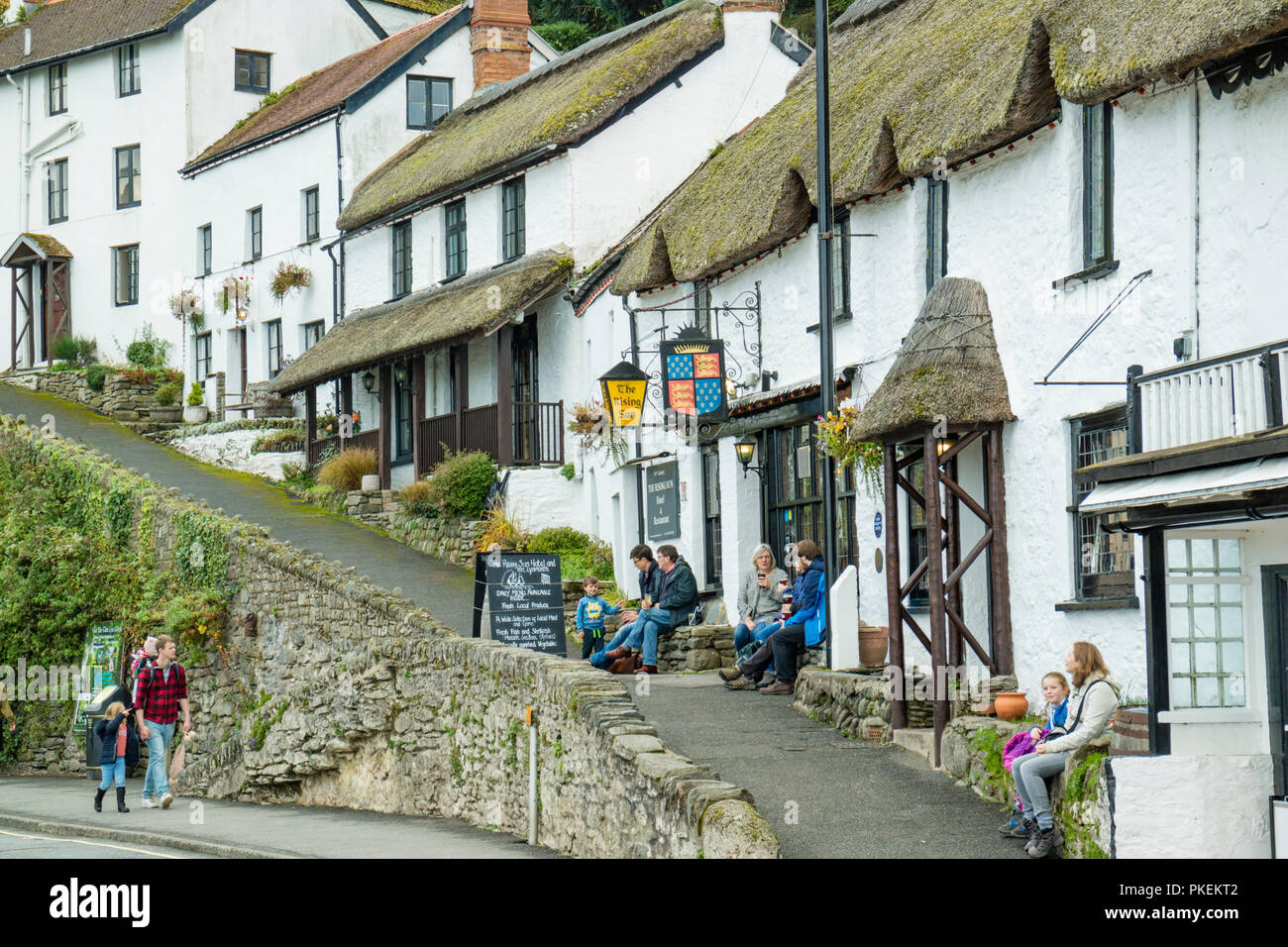 Historic cottages and the14th-century thatched roof hotel the Rising Sun Inn, Lynmouth, Devon, England, UK - Stock Image