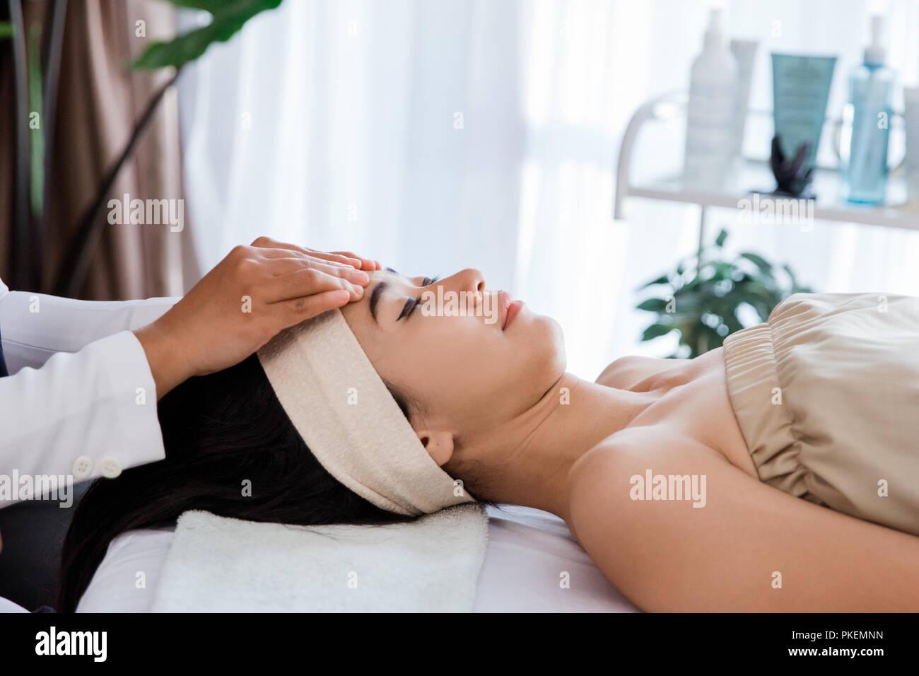 Close up woman enjoying massage - Stock Image