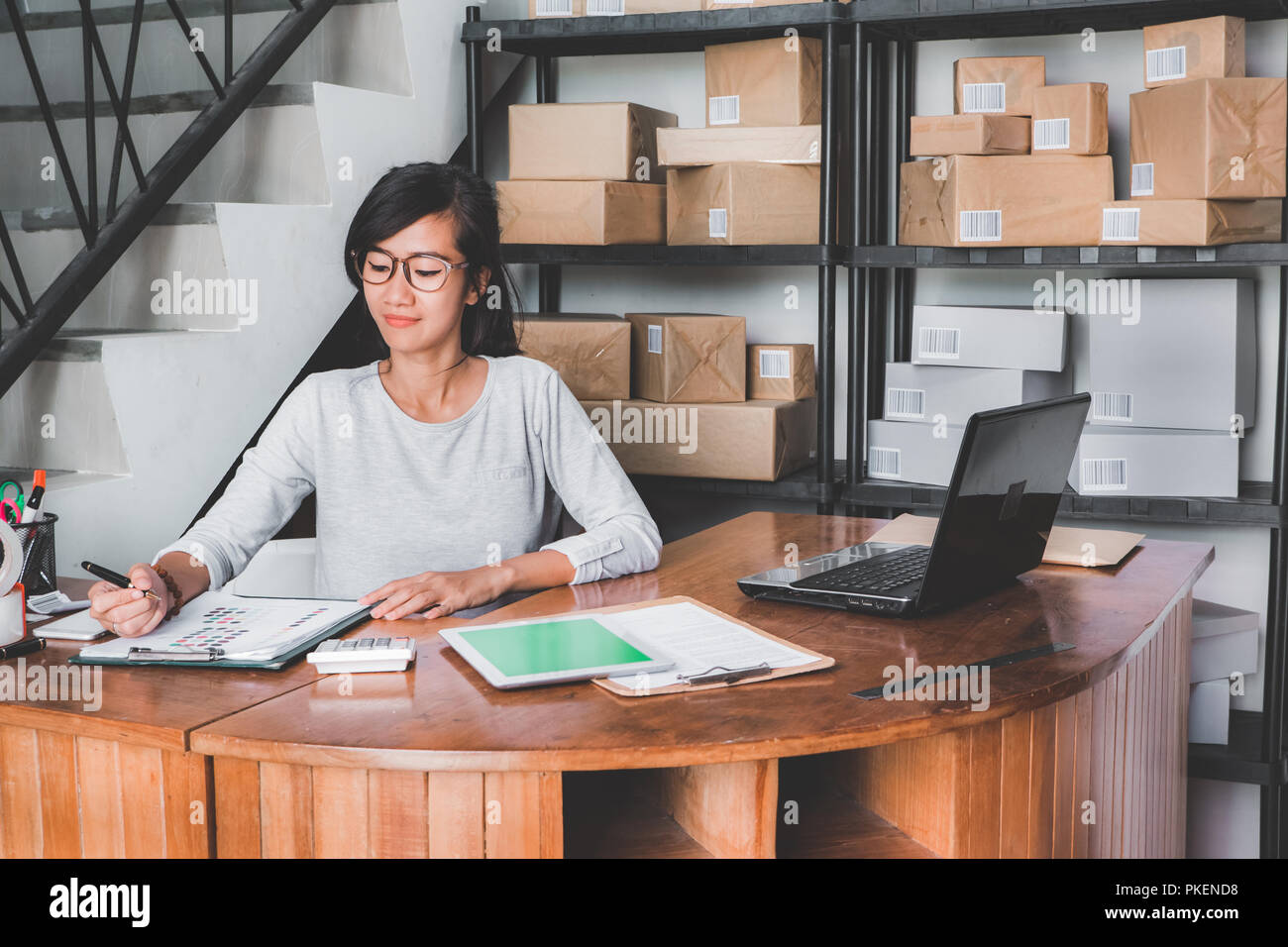online shop seller working at home office - Stock Image