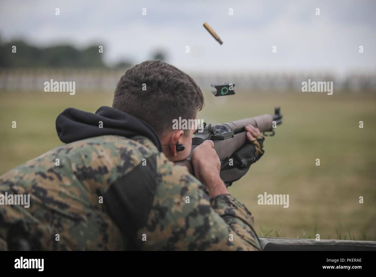 fe095edc0ba U.S. Marine Corps Sgt. Cody Cheney shoots the M1 Garand rifle during the  Hearst Doubles