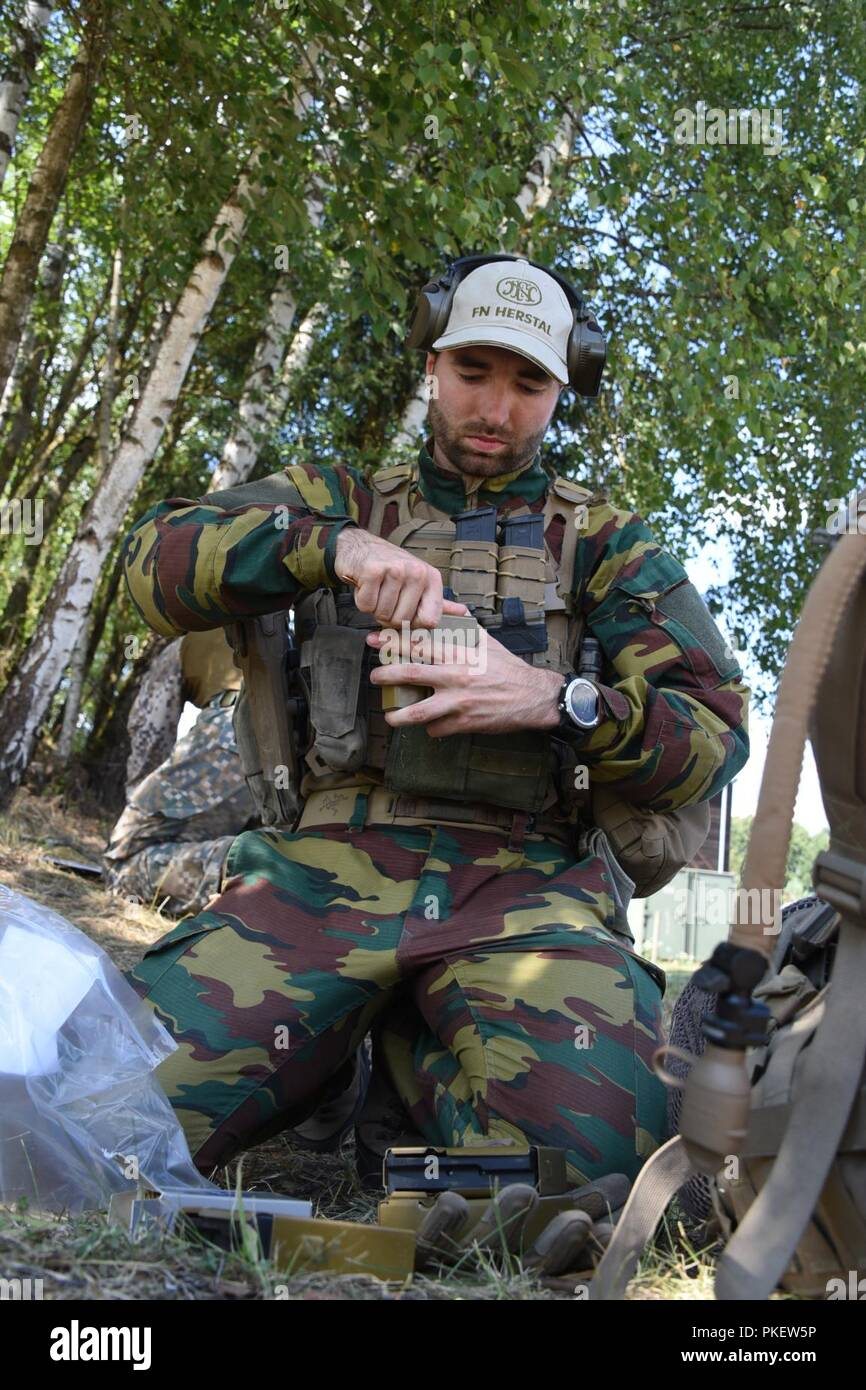 A Belgium soldier loads magazines for the stress shoot event