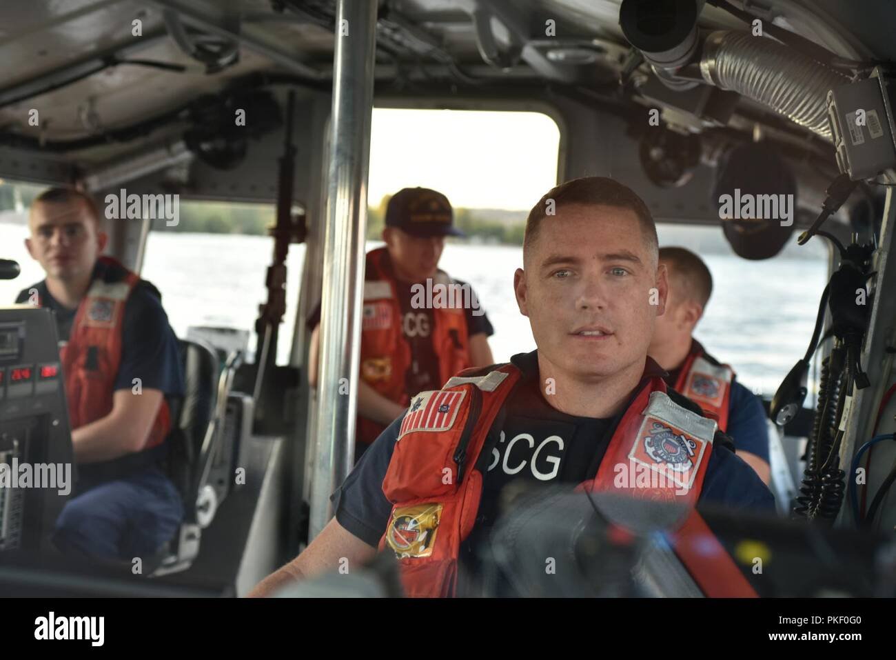 Petty Officer 2nd Class Preston McKernan and a boat crew from Coast Guard Station Seattle patrol Lake Washington aboard a 45-foot Response Boat-Medium, Aug. 3, 2018. The Coast Guard and partnering local and state agencies engaged boaters to help educate them on boating safety and the dangers of boating under the influence during Seattle's Seafair celebration. - Stock Image