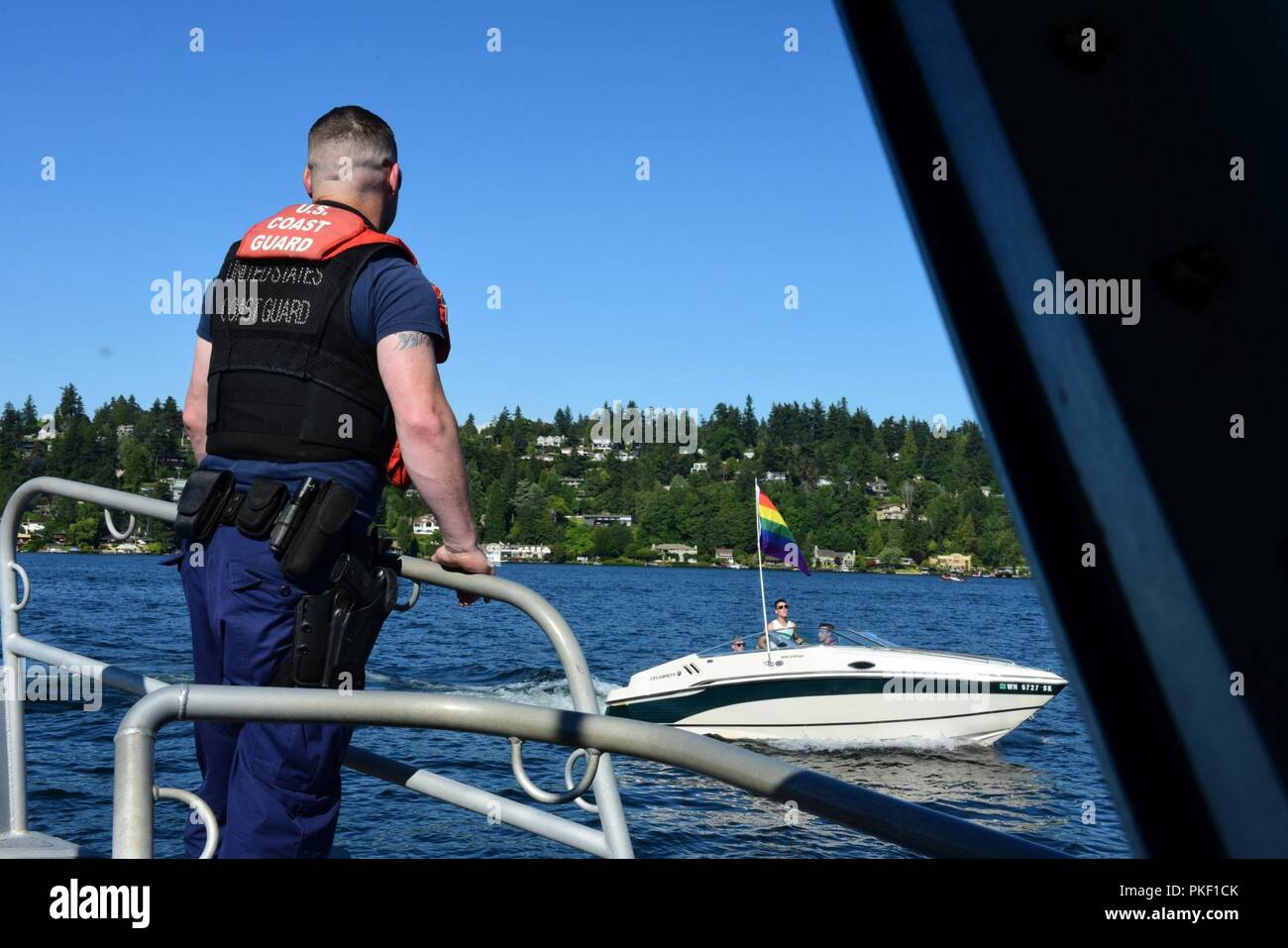 Coast Guard Petty Officer 2nd Class Preston McKernan (left) and Petty Officer 2nd Class Andrew Yester, conduct patrols on Lake Washington, Aug. 4, 2018. Coast Guard crews worked with federal and local law enforcement partners to address boaters operating under the influence of alcohol and drugs. U.S. Coast Guard - Stock Image