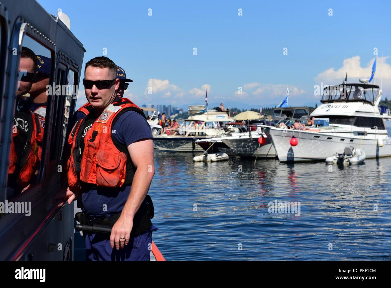 Coast Guard Petty Officer 2nd Class Preston McKernan, a boatswain's mate from Station Seattle, patrols Lake Washington aboard a 45-foot Response Boat-Medium on Aug. 4, 2018. The Coast Guard worked to ensure the safety of all Seafair participants, including boaters, paddle craft operators and swimmers. U.S. Coast Guard - Stock Image