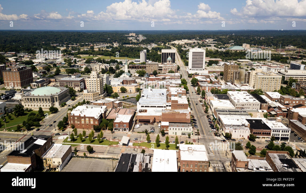 Blue skies with soft white clouds appear in the horizon over the landscape of downtown Macon Georgia - Stock Image
